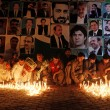 Residents light candles for lawyers killed during the Monday blast at Civil Hospital during a candle light vigil in Quetta